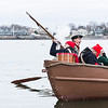 A departing volley is fired as Glover's Marblehead Regiment sets off in the annual row across Marblehead Harbor on Saturday.