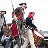 From left, Larry Sands, Captain Seamus Daly, and Mike Cognata of Glover's Marblehead Regiment lead the regiment in Town Landing in Marblehead on Saturday.