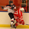 19- 27Salem, Ma. 12-3-17. Robert Stoica, of Revere and C J Graffeo of Saugus vie for the puck.