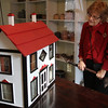 Peabody, Ma. 12-3-17. Ann Birkner looks at a doll house that was built in 1902, which was on display at the Peabody Historic Society and Museum annual Christmas open house at the Felton Jr. House on Sunday.