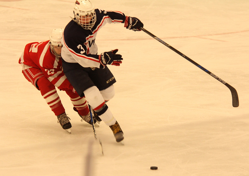 Salem, M a. 12-13-17. Adam Rogrigues of Saugus,tries to get the puck form Cam Mazza of Revere.