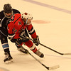 Salem, Ma. 12-3-17. Nick Capillo, 14, of Peabody, and Quinn Brinkler, 22, of Lynn compete for the puck.
