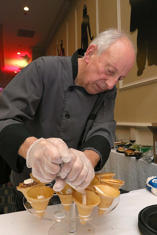 . The HealthAlliance-Clinton Hospital Cat\'s Meow Speakeasy Tasting Gala was held on March 1, 2018 at the DoubleTree by Hilton in Leominster. Slattery\'s owner Dave Celuzza works on preparing some of their dishes they had at the event. SENTINEL & ENTERPRISE/JOHN LOVE