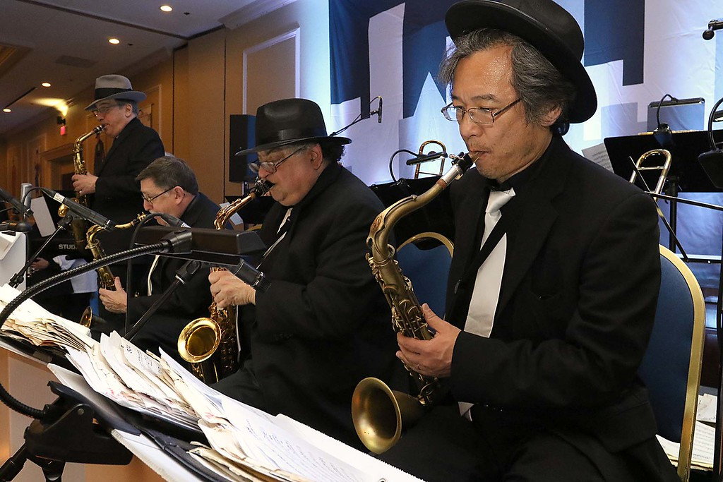 . The HealthAlliance-Clinton Hospital Cat\'s Meow Speakeasy Tasting Gala was held on March 1, 2018 at the DoubleTree by Hilton in Leominster. Playing the saxophone with the Tom Nutile Music at the speakeasy was Kenji Kikuchi. SENTINEL & ENTERPRISE/JOHN LOVE