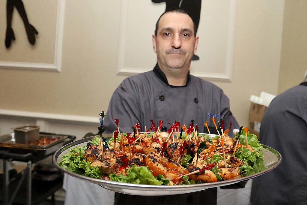 . The HealthAlliance-Clinton Hospital Cat\'s Meow Speakeasy Tasting Gala was held on March 1, 2018 at the DoubleTree by Hilton in Leominster. Slattery\'s Chef Dick Panzarella shows off their chicken satay pops they had for everyone to try at their table at the event. SENTINEL & ENTERPRISE/JOHN LOVE