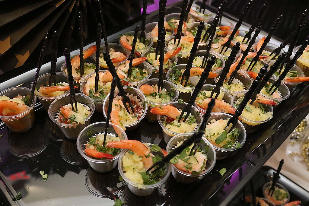 . The HealthAlliance-Clinton Hospital Cat\'s Meow Speakeasy Tasting Gala was held on March 1, 2018 at the DoubleTree by Hilton in Leominster. Some shrimp marinated in pineapple and cilantro served with pineapple salsa was being served at the Sterling Village Rehab\'s table at the event. SENTINEL & ENTERPRISE/JOHN LOVE
