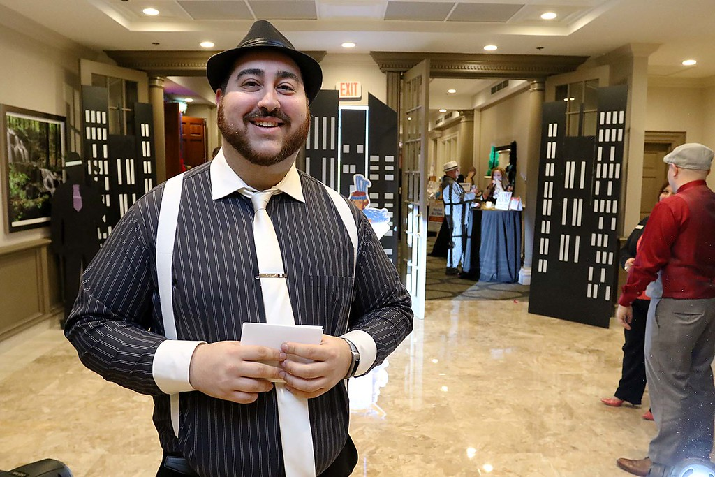 . The Healthalliance-Clinton Hospital Cat\'s Meow Speakeasy Tasting Gala was held on March 1, 2018 at the DoubleTree by Hilton in Leominster.  Manning the door into the event was North Central Massachusetts Chamber of Commerce\'s Member Services Associate David Ginisi all dressed up for the event. SENTINEL & ENTERPRISE/JOHN LOVE