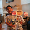 "caleb's ""self doll"" that he made for school. it's an astronaut (he researched astronauts online to try to make his look like the real suit). for the astronaut patches, he decided to put patches of his favorite things. from the top left, the patches are ""little brother micah,"" ""space ship,"" ""basketball,"" ""rocket,"" ""darth vader,"" and ""batman."""
