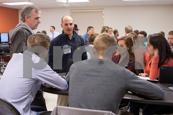 Sam Buckner for Shaw Media.<br /> Students get feedback on their business ideas from local busines men, James Wilson and Steve Goodwill on Thursday December 1, 2016.