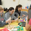 Sam Buckner for Shaw Media.<br /> NIU Softball players Tara Thacker, Katie Lamich, Jenny Van Geertry and Sam Schmitd decorate cookies at Club 55 after helping seniors decorate theirs on Friday December 1, 2017.