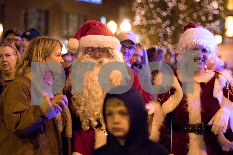 Sam Buckner for Shaw Media.<br /> Santa and Mrs. Claus parade through downtown Sycamore along with Children and their families to the Courthouse lawn where they lit the Christmas trees.