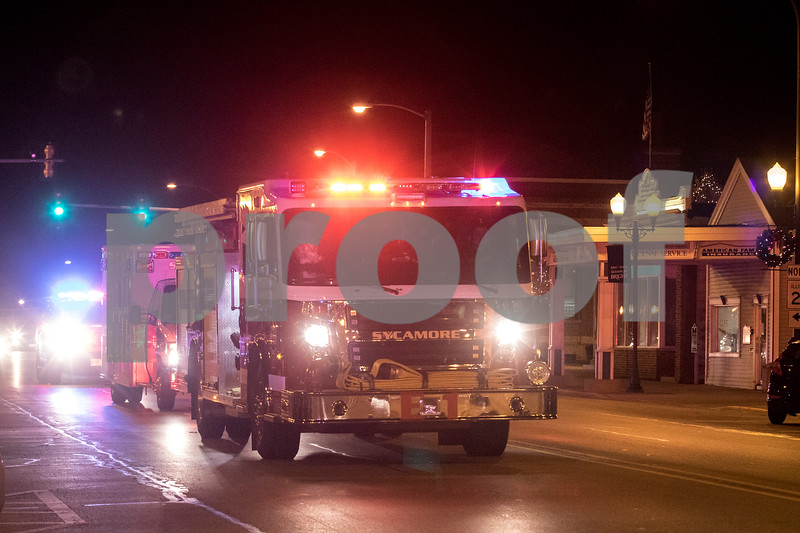 Sam Buckner for Shaw Media.<br /> Santa and Mrs. Clause ride with the Sycamore Fire Department through downtown Sycamore on Friday December 1, 2017.