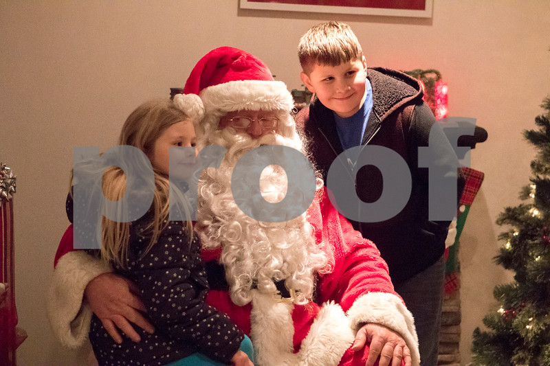 Sam Buckner for Shaw Media.<br /> Shailyn 5, and Kazmo Schroeder 9, pose with Santa Claus on Friday December 1, 2017 outside the Dekalb County Courthouse. Children can visit with Santa on Fridays from 5-7pm, Saturdays 11am-2pm, and Sundays from 12-2pm through Saturday, Dec. 23.