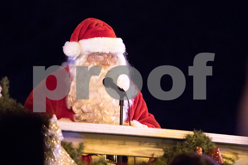 Sam Buckner for Shaw Media.<br /> Santa Claus asks everyone in attendance to help him light the trees on the courthouse lawn on Friday December 1, 2017. Children can visit with Santa on Fridays from 5-7pm, Saturdays 11am-2pm, and Sundays from 12-2pm through Saturday, Dec. 23.