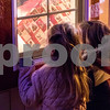 Sam Buckner for Shaw Media.<br /> Elena Staley 4, and Zoe Batiste 4, look inside a window to see Santa and Mrs. Claus on Friday December 1, 2017. Children can visit with Santa on Fridays from 5-7pm, Saturdays 11am-2pm, and Sundays from 12-2pm through Saturday, Dec. 23.
