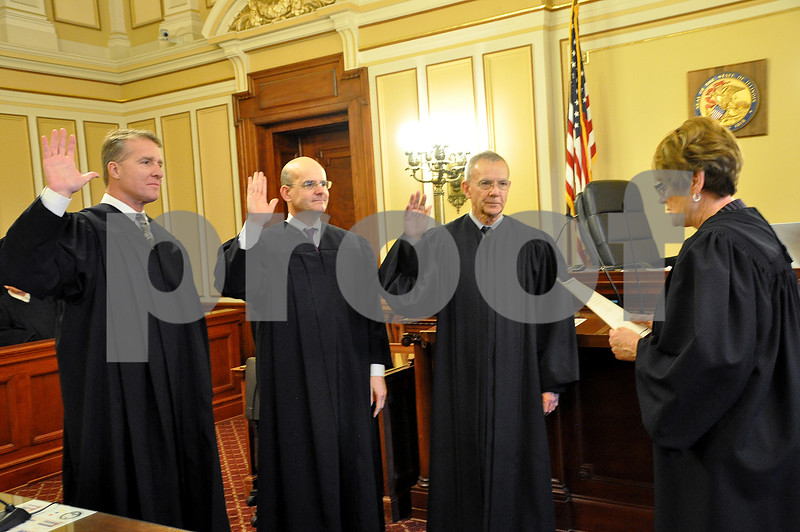 Photograph by Barry Schrader for Shaw Media<br /> <br /> Chief Judge Robbin Stuckert, right, swears in judges.