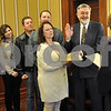 Photograph by Barry Schrader for Shaw Media<br /> <br /> Chief Judge Robbin Stuckert, right, swears in DeKalb County Coroner Dennis J. Miller, second from right.