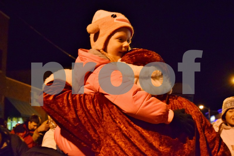 On Friday, Dec. 2, Mia Rose Davis of Genoa, 4, hugs Santa Claus during Celebrate the Season in downtown Genoa.