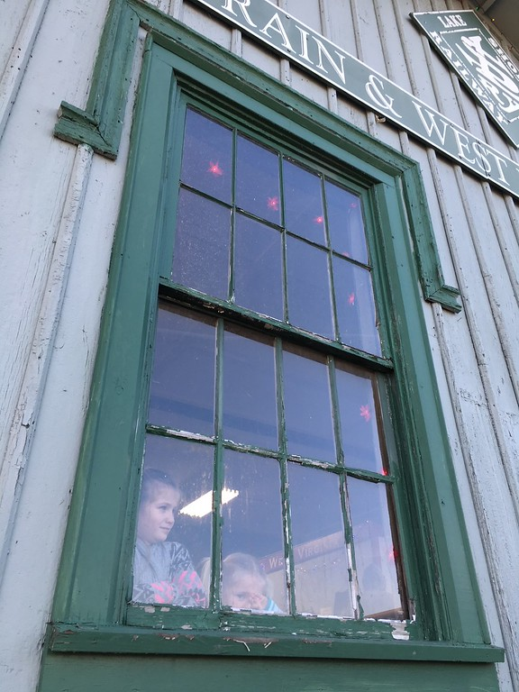 . Richard Payerchin - The Morning Journal <br> Sisters Jillian Johnson, 7, left, and Evelyn Johnson, 4, of Mount Eaton look out the window to watch for the Santa Train before they ride on Dec. 2, 2017. The Santa Train is in its second year on the Lorain & West Virginia Railway of the Lake Shore Railway Association in Wellington.