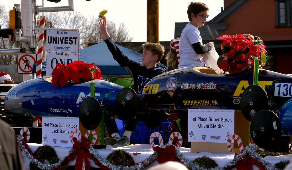 . Soap Box Derby members throw candy during the Souderton Holiday Parade Dec. 2, 2017. (Bob Raines--Digital First Media)