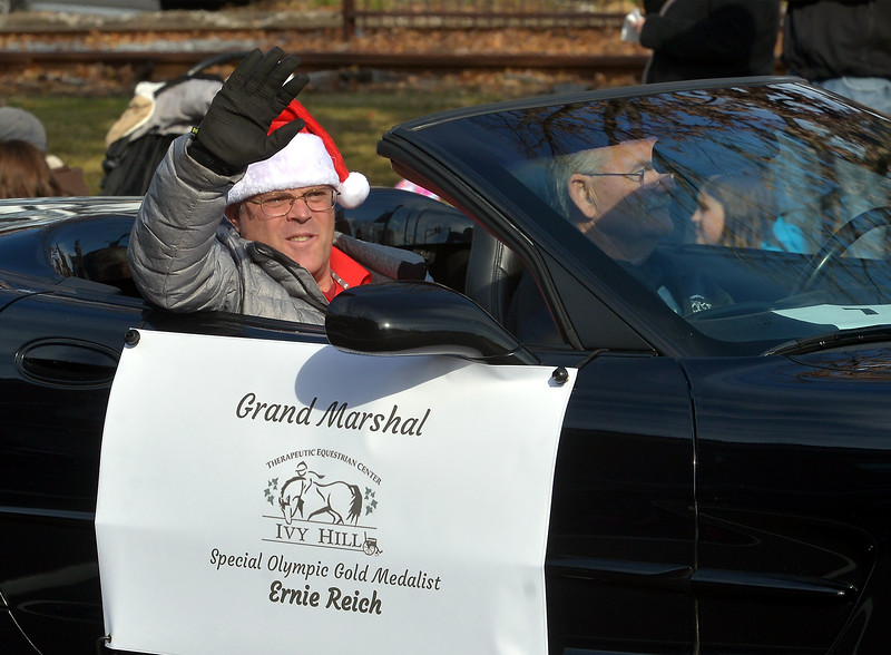 Ernie Reich, the Grand Marshal of the Souderton Holiday Parade, waves to spectators Dec. 2, 2017. (Bob Raines--Digital First Media)