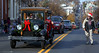 A line of vintage automobiles stretches several blocks along N. Main St. during the Souderton Holiday Parade Dec. 2, 2017. (Bob Raines--Digital First Media)