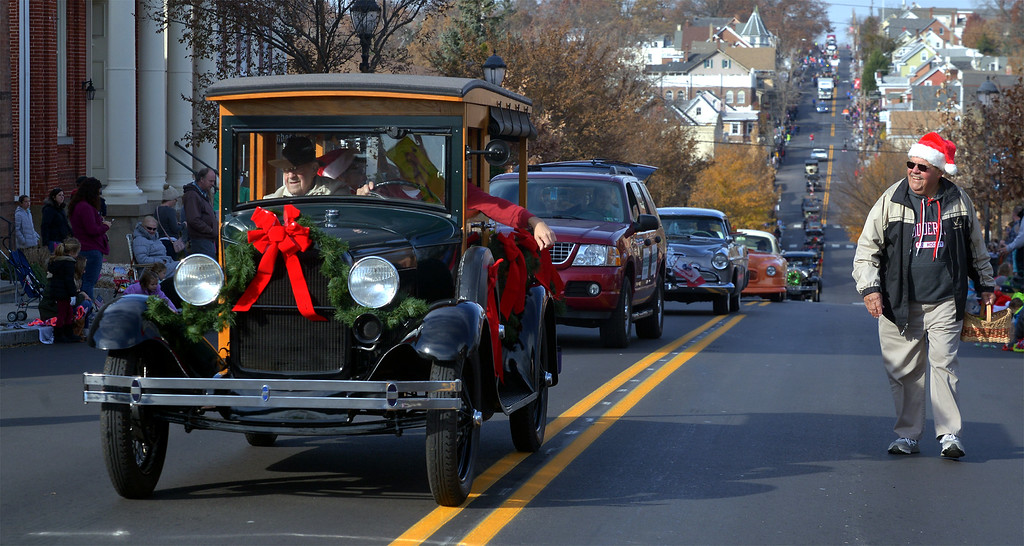 . A line of vintage automobiles stretches several blocks along N. Main St. during the Souderton Holiday Parade Dec. 2, 2017. (Bob Raines--Digital First Media)