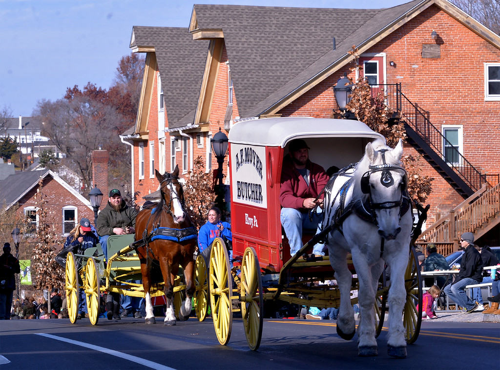 . JBS-Mopac meat packers brought two antique horse-drawn butcher wagons to the Souderton Holiday Parade Dec. 2, 2017. (Bob Raines--Digital First Media)
