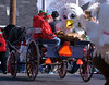 Univest's horse-drawn cart carries a pair of elves and a bird mascot at the Souderton Holiday Parade Dec. 2, 2017. (Bob Raines--Digital First Media)