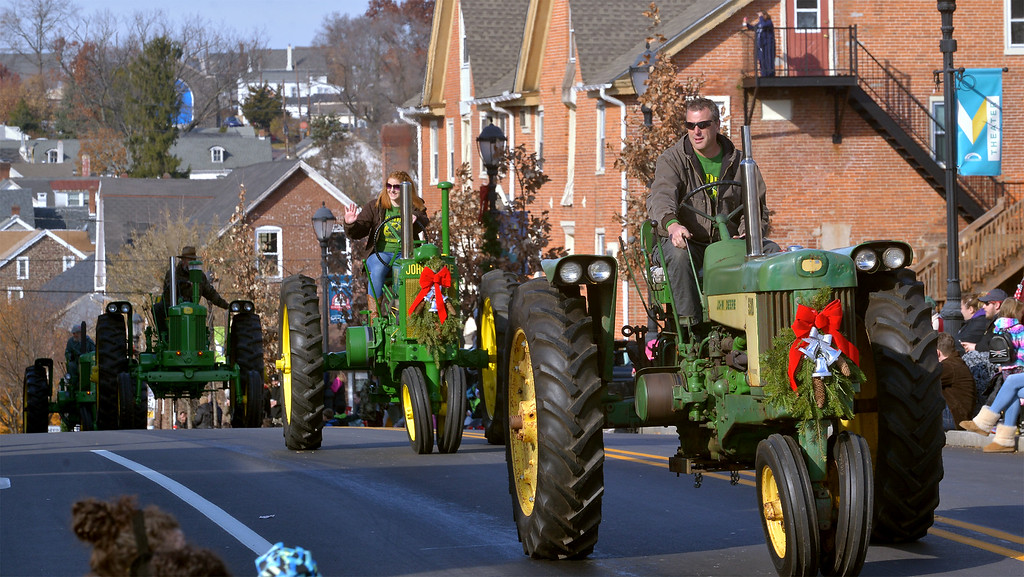 . A line of farm tractors from the 2-Cylinder Club climbs N. Main St. during the Souderton Holiday Parade Dec. 2, 2017. (Bob Raines--Digital First Media)