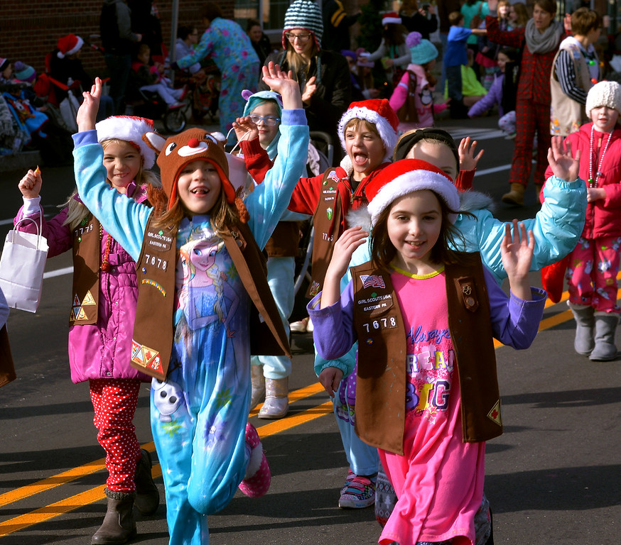 . Girl Scout Troop 7678 seems quite happy to march in their pajamas in the Souderton Holiday Parade Dec. 2, 2017. (Bob Raines--Digital First Media)