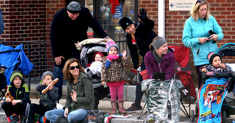 Families line the sidewalk during the Souderton Holiday Parade Dec. 2, 2017. (Bob Raines--Digital First Media)