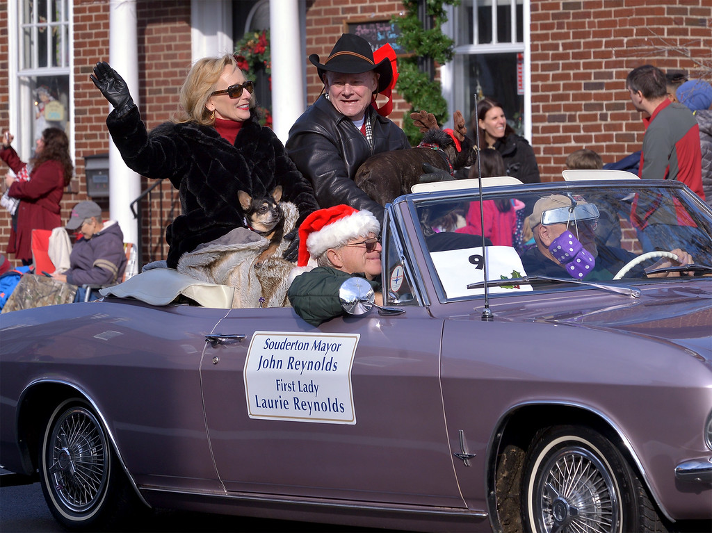 . Souderton Mayor John Reynolds and his wife,  Laurie, wave to the crowd during the Souderton Holiday Parade Dec. 2, 2017. (Bob Raines--Digital First Media)
