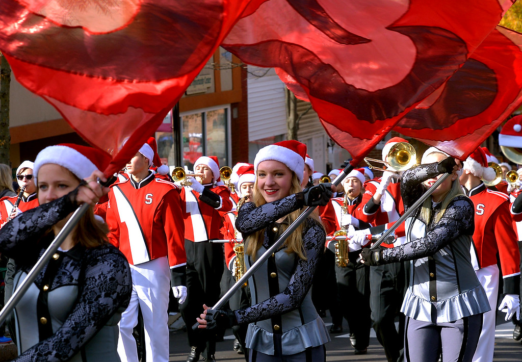 . The Souderton Marching Band Color Guard precedes the musicians as the climb N. Main St. during the Souderton Holiday Parade Dec. 2, 2017. (Bob Raines--Digital First Media)