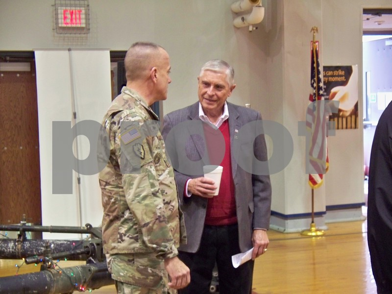 Rep. Robert Pritchard (right) talks to Land Components State Sgt. Maj. Mark Bowman, who is in charge of all enlisted personnel in the state of Illinois.