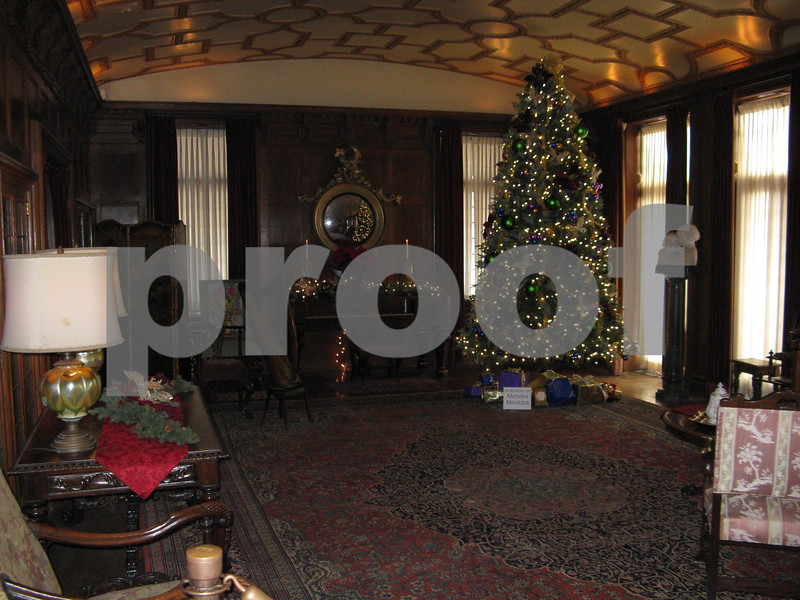The Ellwood House living room is filled with Christmas decorations during the mansion's Holiday Open House event Saturday.
