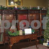 Kathy Hallgren, Linda Wahlstrom and Lois Miller were responsible for decorating the Ellwood House's library for the Holiday Open House on Saturday in DeKalb.