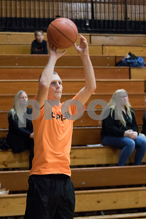 Sam Buckner for Shaw Media.<br /> Andrew Sperry shoots in a 3-point shooting contest during halftime of the Guns and Hoses VS. District 428 staff fundraiser game for Toys for Tots on Monday December 4, 2017.