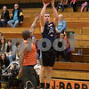 Sam Buckner for Shaw Media.<br /> Josh Bolt takes a jumpshot on Monday December 4, 2017 at the Toys for Tots fundraiser game.
