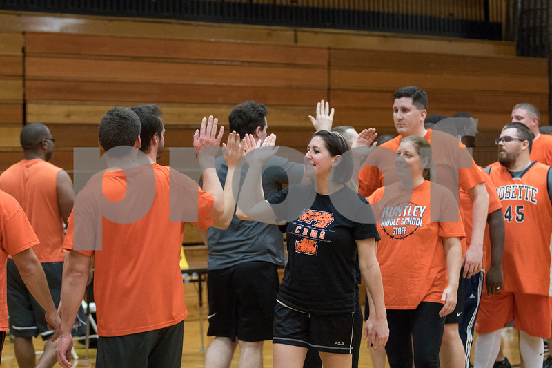 Sam Buckner for Shaw Media.<br /> Players high five at the end of the Toys for Tots fundraiser game on Monday December 4, 2017.