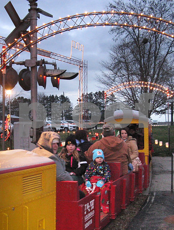 Aimee Barrows – news@daily-chronicle.com<br /> Bundled-up passengers pull into the station aboard the Holiday Lights Train in Waterman on Saturday.