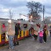 Aimee Barrows – news@daily-chronicle.com<br /> Passengers climb aboard the Holiday Lights Train at Lions Park in Waterman on Saturday.