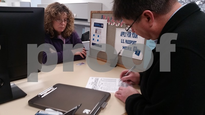 Christopher Heimerman – cheimerman@shawmedia.com<br /> Simpson signs his petition in order to have it notarized before filing it.