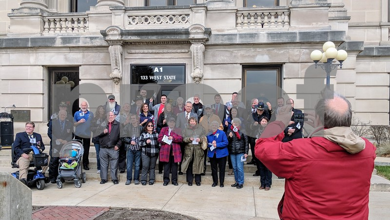 DeKalb County administrator Gary Hanson takes a picture of everyone who attended the flag raising ceremony. County board president Mark Pietrowski read a proclamation and county historian Sue Breese gave a bit of history of DeKalb County.