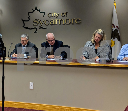 Mayor Curt Lang (center) asked the Sycamore City Council on Monday night if there were any questions about an ordinance to change the Ellen Street to no parking during the City Council meeting. The ordinance makes the road safe for emergency vehicles and snow removal operations.