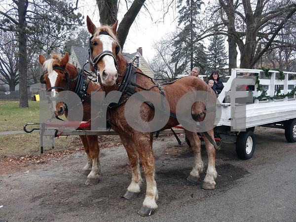Katrina J.E. Milton – kmilton@shawmedia.com<br /> Philip and Sarah Nielsen gave horse-drawn wagon rides during the Waterman House Walk on Saturday, Dec. 13. Riding in the wagon are David and Tessa Acker and their sons, Ben, 7, and Sean, 5.