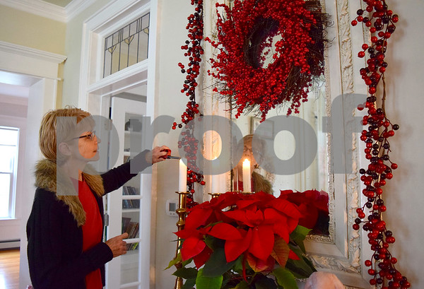 Becky May lights candles as she decorates her house for the Waterman Christmas House Walk. May's house, 430 N. Elm St. in Waterman, will be one of five houses on the walk, which will take place from noon to 4 p.m. Saturday, Dec. 10.