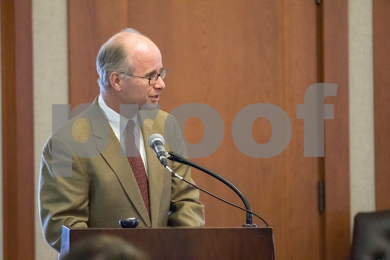 Sam Buckner for Shaw Media.<br /> Charles Philbrick speaks on behalf of Misty Haji-Sheikh on Thursday December 7, 2017 who won a lawsuit to block former NIU President Doug Baker's payout.