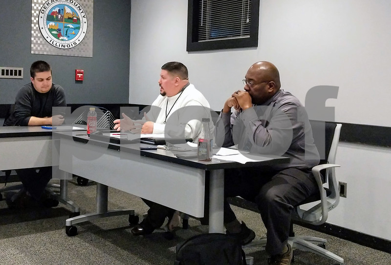 Community Development Director Derek Hiland (center) answered questions from the DeKalb County Planning and Zoning Committee on the solar ordinance that has been in the works since September.