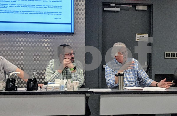 Craig Roman (left) and Steve Faivre, members of the planning and zoning committee, discussed Wednesday the changes they wanted in the ordinance. The committee voted to move the ordinance to a public hearing, date and time to be determined.